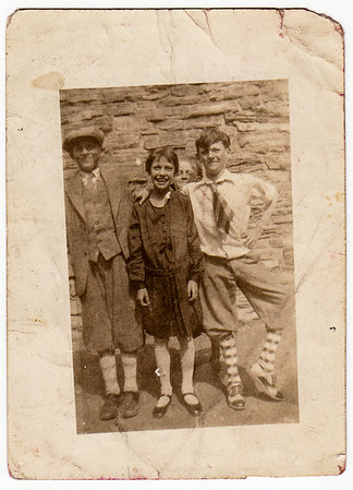 Verna Humma with Leonard Whitehead, William Marlow and Jerry Boyer. 1930, 4th grade. Can anyone identify who is who of the boys?