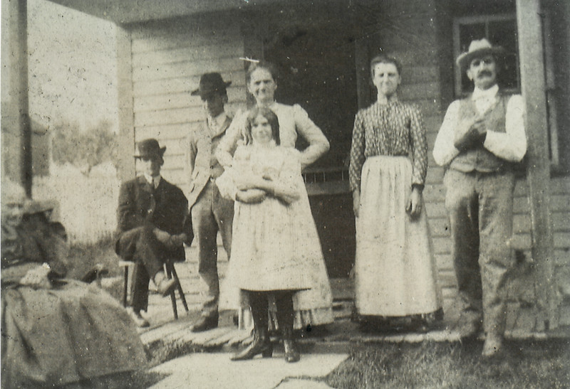 According to Vera (Naftzinger) Schrack…<br /> Dated of photo: 9/1/1897.<br />  L-R: <br /> 1) Great-Grandmother Marie (Mary) A. (nee Schock) wife of Israel Miller.<br /> 2) Elmer Henne (later married to Grace G. Reber).<br /> 3) Charles Henne (later married to Anna L. Wenz).<br /> 4) (front) Mom Molly Henne (later married Joseph E. Naftzinger)<br /> 5) (behind Molly) Laura Henne (later married to Benjamin W. Reichert)<br /> 6) Grandmother Ellen (Miller) Henne<br /> 7) Grandfather Albert Henne.<br /> Other:<br /> > #'s 2-5 are siblings, <br /> > sibling Annie May Henne (later married to Benjamin F. Kline) is missing.<br /> > #'s 6 & 7 are married.<br /> > #1 is mother to #6.