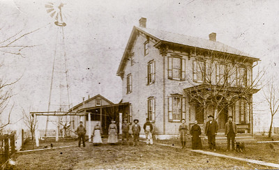 Mary Jane Kauffman (2nd from left) in front of Naftzinger corner house.