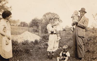 From left: Molly Harriet (Henne) Naftzinger, Roy Becker holding Anna Schrack, Wayne Schrack, Jr. (toddler on ground), Joseph Emory Naftzinger holding John Schrack, on the Becker farm.