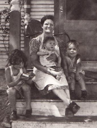 From left: Anna Schrack, Mollie (Henne) Naftzinger holding (Norman??) Schrack, Daniel Schrack