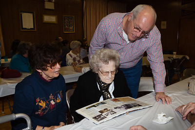 Peggy (Naftzinger) Reppert, Grace (Naftzinger) Schlenker and Daivd Schlenker, reminiscing with 'Our Schrack Family Heritage' album.
