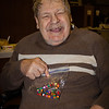 Norman Schrack, proudly holding up a necklace he made. (Son of Wayne and Vera (Naftzinger) Schrack).