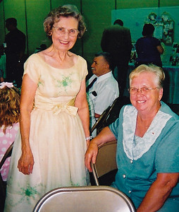 Anna (Schrack) Reinhart with Beverly (Long) Schrack. Event: The 50th anniversary of John and Marie (Scrhack) Hill.   Anna (Marie's sister) is wearing the bride's-maid dress that she wore to Marie's wedding 50 years earlier!