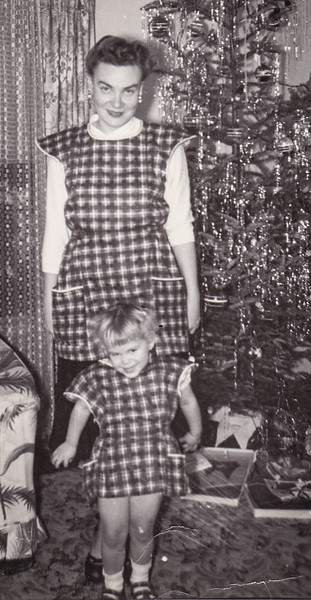 Pat with her mother Alice, wearing the maching aprons her mom had made (1950 - 1951). It was one of her dad's favorite photos and he kept it in his wallet.