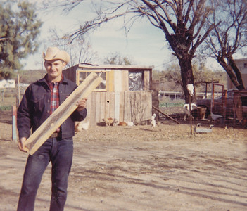 Ben was walking out in a dry pasture area and he almost stepped on this rattlesnake - he had a 22 rifle with him, so he shot it - and took it back to our trailer and skinned it and put it on this piece of lumber  -   Jan. 1968 - 2nd trailer in San Antonio.