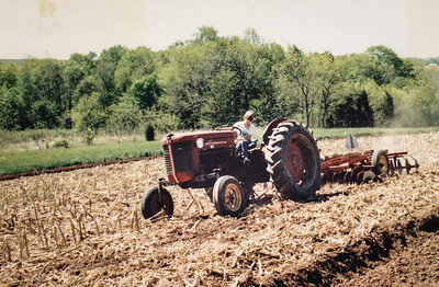 Brian discing a field i Bucks Co., PA farm, 1986. He was 10 years old and was a master at handling the tractor.