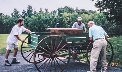 When Carlyn and Doreen visited Paw Paw and Gram, as young girls, they always loved to play on his wagon. So Charles wanted them to have it. Here they packing it up to give to Carlyn. L-R: Ted Axarlis (friend), Phil Krall (back) and Bobby Schrack. The table in the wagon belonged to Charles' grand-father John Adam Schrack. Photo taken Sept 2007.