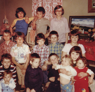 The kids at Vera's easter egg hunt, 1979. Back: Scott Haag,  ?  , Carlyn Kreiner. Middle: Steve Schrack, Brian Haag,  ?  , Curtis Schrack, Doreen Kreiner. Front: Eric?? holding Wesley??,   (boy in blue)??, (boy in blue)??,  Denise Schrack holding babies Chad Emerich (white) and Gwen Schrack (red).