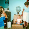 Meda had this beauty shop in the front room of their ranch home. <br /> Ethan is brushing his mother Carlyn's hair. Meda watching Lauren on the beauty chair.