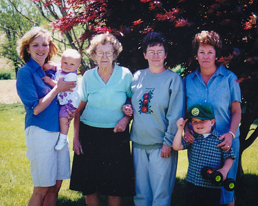Carlyn holding Lauren, Meda, Marilyn and Leanna with Ethan.