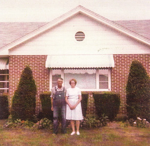 Charles and Meda, in front of their house.