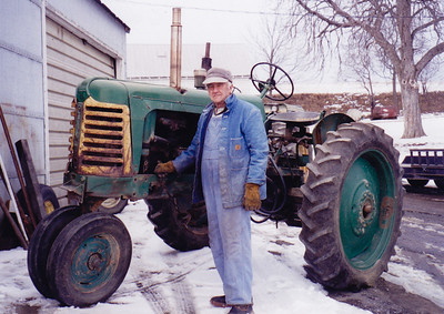 Charles Schrack with his '66 Oliver Tractor. (Feb 2001).