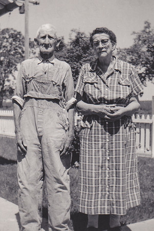 Charles and Katie Schrack; Notice the tuck Florence needed to sew in the bib of Charles' overalls, otherwise if would come up and cover his chin because he was so short.