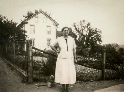 Katie Schrack, at her house, circa 1923.