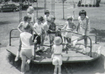 The first Schrack picnic, 1964. Meg Langley (little girl front center facing away).  Debra Bender (on the right, dark hair looking at camera).  Donna Bender (dark hair, back center).  Susan (far left, pointing in). Can anyone identify the other children ….??