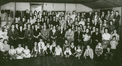 Charles & Katie Schrack's 50th anniversary party 1952. (Married 4 Oct 1902), and their friends and family… 1st Row: 1-Marie Schrack, 2-Betty Schrack, 3-Marilyn, 4-Leanna Schrack, 5-Lois Crist, 6-Raymond Crist, 7-Richard Schrack, 8-Myron Schrack, 9-Linda Henne, 10-Carol Crist, 11-Clyde Heckler, 12-Cathy Kramer, 13-Crissie Kramer, 14-Leslie Crist, 15-David Schrack, 16-Elmer Schrack. 2nd Row: 17-Roy Schrack, 18-Mae Schrack, 19-John Schrack, 20-Florence Schrack, 21-John Faust, 22-Katie Schrack, 23-Charles Schrack, 24-Sallie Buckwalter, 25-Wayne Schrack, 26-Vera Schrack holding 27-baby Michael, 28-Charles Schrack, 29-Meda Schrack, 30-Larry Schrack, 31-Terry Schrack. 3rd Row: 32-Eva Hess, 33-Bob Hess, 34-Laura Hastings, 35-Ed Faust, 36-Verna Faust, 37-Leah Moyer (Noecker), 38-Mary Moyer, 39-Milton Faust, 40-Annie Moyer, 41-Lillie Faust, 43-Jim Moyer, 43-Pearl Henne, 44-Florence Schrack, 45-Rosie Stiteler, 46-Anna Crist, 47-Mary Rieff, 48-Florence Heckler, 49-Elvie Troutman, 50-Norman Schrack. 4th Row: 51-Riley Schrack, 52-Emily Crist, 53-Esther Crist, 54-Grace Crist, 55-Alice Crist, 56-Ann Crist, 57-Mr. Noecker (Leah Moyer's husband), 58-Marie Heckler, 59-Mary Irey, 60-Jim Faust, 61-Kathryn Kramer, 62-Willis Faust, 63-Henry Faust, 64-Claude Crist, 65-Wayne Schrack Jr, 66-Lynwood Heckler, 67-John A. Schrack, 68-Grampa Abram Heckler, 69-Daniel Schrack, 70-Robert Schrack, 71-Earl Schrack, 72-Dolores Schrack, 73-Mrs Leroy Schrack, 74-Ed Rieff, 75-Leroy Schrack, 76-Clint Crist, 77-Walton Heckler, 78-Dorrie Heckler, 79-Charles Irey. 5th Row: 80-Ruth Crist, 81-Elizabeth Crist, 82-Joan Hastings, 83-Judy Hastings, 84-Esther Crist, 85-Anna Schrack, 86-Mary Schrack, 87-Mary Margaret Schrack, 88-Howard Faust, 89-Roy Rentschler, 90-Stanley Heckler, 91-Earl Crist, 92-Ronnie Crist, 93-Crist, 94-Ralph Stiteler, 95-Walter Crist,  96-Joe Hastings, 97-Herbert Crist, 98-Ralph Crist, 99-Frank Kramer.