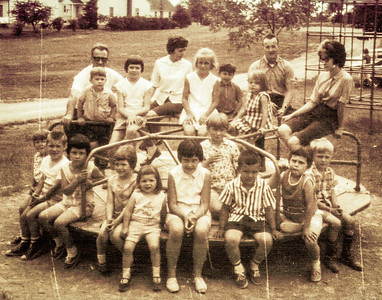 Many family members on the merry-go-round at the 1966 Schrack Reunion, Shartlesville. Front: Linda and Dennis Schrack, Donna Bender, Dawn and Karen Schrack, Debbie Bender, Cheryl Reinhart, David Bender, Susan Reinhart, Bart Hill. Back: Uncle John Schrack, Allen Reinhart, Yvonne Stricker-Schrack,  ?,  ?,  ?, Beth Hill, Barry Light, Leanna Schrack.