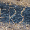 These are the initials that Earl scratched in the wood in the barn when he was little.