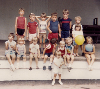 Children at the Schrack Reunion, 1986, Shartlesville.  Standing Back row, L-R: 1) Wesley Henne, 2) Ben Schrack, 3) Chad Emerich, 4) Neal Schrack, 5)?, 6) Stacy Emerich, 7) Lynne Sechler (holding yellow ball).  Sitting row, L-R: 1)?, 2) Amy Schrack, 3) Laura Schrack, 4)? (red shirt), 5) James Hill, 6)John Hill, 7) Valerie Henne.  Front standing: 1)Megan Hill