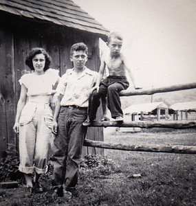 Roy and Mae's children: Mary (Bender), Bob and David, at uncle Mack and Pearl Hoffman's farm. (Pearl is Mae's sister.)