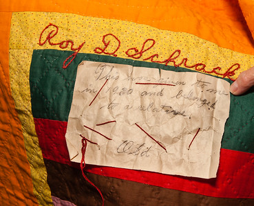 "Mother Katie had an old unnamed relative make a quilt for each son. This one is embroidered for son Roy. Katie wrote the attached note that says ""This was given to me in 1930 and belonged to a relative."""