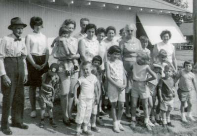 At the 1st Schrack picnic, 1964.  L-R: Charles Schrack, Gayle Schrack, Dolores(?) holding little girl, Bobby(?, in back), Mary Bender (center) with her hands on her daughter's shoulders, Anna (back), Mae(?, back), ?(back woman), Florence (tall, white hair). Kids in front, L-R:   ? (boy), (?)boy, (?)child(almost unseen), Donna Bender, Debra Bender, Cheryl Reinhart(?)