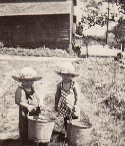 Mary and Wayne, Jr., at Grandma & Grandpa Schrack's farm. (Charles and Katie).