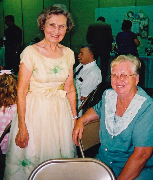 Anna (Schrack) Reinhart with Beverly (Long) Schrack.<br /> Event: The 50th anniversary of John and Marie (Scrhack) Hill. <br /> <br /> Anna (Marie's sister) is wearing the bride's-maid dress that she wore to Marie's wedding 50 years earlier!