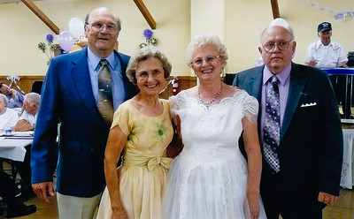 John and Marie (Schrack) Hill's 50th anniversary. L-R: Harold and Anna (Schrack) Reinhart, Marie (Schrack) and John Hill. Note: Marie's sister Anna and Harold Reinhart were their maid-of-honor and best-man 50 years earlier. Amazingly, Marie and Anna are wearing the same dresses they wore 50 years earlier. Marie's dress needed a minor alteration, Anna's dress needed none.