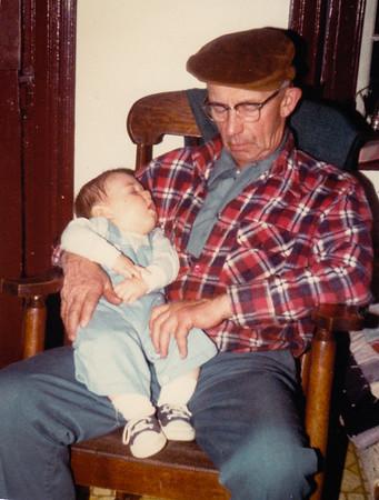 Wayne Schrack holding his grandson Ben - both fell asleep. March1980.