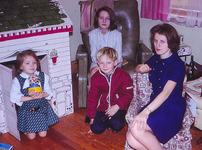 Front, L-R: Beth A. Hill (later Humma), Bart W. Hill, with their mother Marie (Schrack) Hill. Behind is Debby Pickle who lived with Hills for extended time.