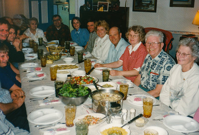 Wayne and Vera Schrack invited the extended Hill family for a meal. L-R (visible faces only): James Hill, Jesse Hill, Lori (Ford) Hill, Vera (Naftzinger) Schrack, Norman Schrack, Beth (Hill) Humma, Jeb Humma, Lois and John Ford, Marie Hill, ____, _____.