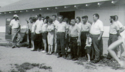 The first Schrack picnic, 1964. L-R: Roy, Elmer(?), woman(looking back), man (in back), Dennis (white shirt up front), 2 people 'hiding' in back(?), Betty (next to Dennis), next couple likely Myron and Linda(?), John H. Schrack, woman (behind), Norman Schrack, Meda (behind), Charles, man(?)(behind), boy(?), Donald Bender.