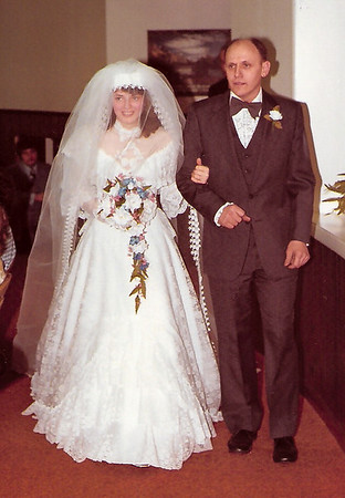 Beth Hill (Humma), being walked down the isle by her father John M. Hill. Jan 10, 1981.