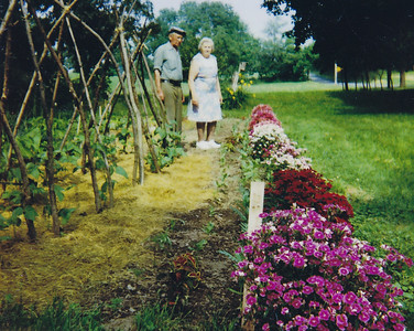 Wayne and Vera (Naftzinger) Schrack standing by their garden at their home (Naftzinger homestead). Throughout their entire lives, they always had a large very productive garden.