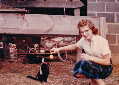 Marie Schrack (later Hill), with pet skunk.