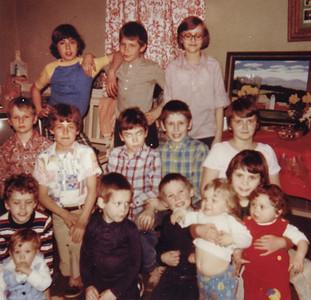 The kids at Vera's easter egg hunt, 1979. Back: Scott Haag,  ?  , Carlyn Kreiner. Middle: Steve Schrack, Brian Haag,  ?  , Curtis Schrack, Doreen Kreiner. Front: Eric?? holding Wesley??,   (boy in blue)??, (boy in blue)??,  Denise Schrack holding babies Chad Emerich (white) and Gwen Schrack (red).
