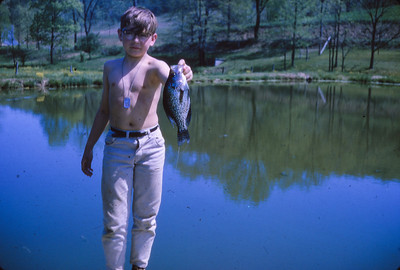 Michael Schrack at the pond of John and Marie (Schrack) Hill (his sister) - caught a big one.