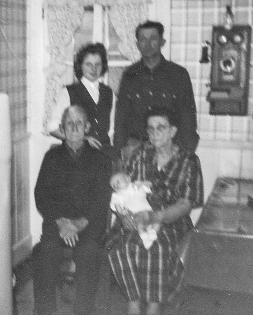Four generations: Charles and Katie (Faust) Schrack (seated), their son Wayne Schrack (standing), Wayne's daughter Marie Hill (standing), Marie's son Bart (baby). 1960.  Phot taken in Charles and Katie's kitchen.