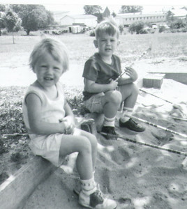 The first Schrack picnic, 1964. Meg Langley and Allen Reinhart playing in the sand box.