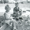 The first Schrack picnic, 1964.<br /> Meg Langley and Allen Reinhart playing in the sand box.