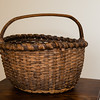 Ray Strausse, from Strausstown, very well known for fine quality baskets, made this basket around 1880-'90's.  It was given to Charles H Schrack from Jim Moyer. Charles used it mainly for picking huckleberries. His son Wayne Sr. then used it mostly for huckleberries, but also eggs and potatoes. Ray Strausse's son repaired the basket.