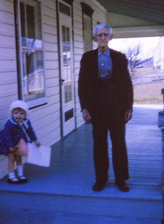 Charles H. Schrack on his front porch with his great-grand-daughter Beth Hill (later Humma). (Beth born 1962).
