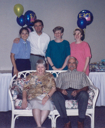 Ronald Humma's retirement party, July 4, 1998. He retired on June 30, 1998. Ronald and Marian (Werner) Humma, (front), Beth (Hill) (wife of Jeb), Jeb, Cathy & Lisa Humma.