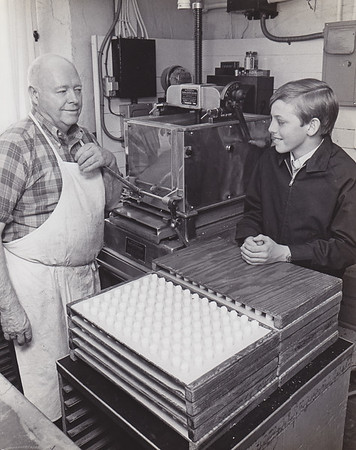 After retiring from his grocery store, Claude Werner worked for Billy's Candy, seen here with an unknown boy, located on Kutztown Road, Temple, PA.