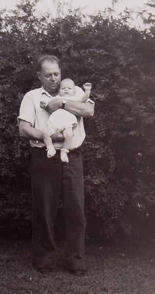 Claude Werner holding his son Stephen.