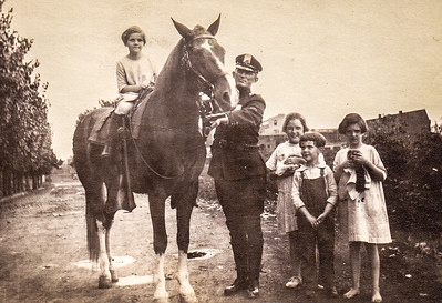 Mildred Yeich on horse, Officer George Clark, Mary Hilferty, Donald and Virginia Yeich and kittens