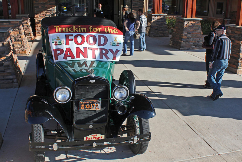 Chris Anderson of Countryside Community Church volunteered use of his 1930 Ford pickup for this event.<br /> <br /> As folks arrived for church on Saturday night or Sunday morning, this colorful vehicle greeted them -- with a reminder!