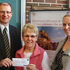 "<b>WELLS FARGO <I>WORKERS DONATE TO PANTRY.</I></b> John Senden, the president of Wells Fargo Community Bank in Spearfish presents a check for $160 to pantry president Karen Miller on Tuesday, March 27th, 2012. At right is Miranda Patek, Store Manager.  To help celebrate 160 years of Wells Fargo banking, local employees contributed $160 to help support the purchase of items for the pantry.  Many thanks to our good friends at Wells Fargo in Spearfish!    Return to<a href=""http://www.spearfishpantry.net""> <b><i>Spearfish Community Food Pantry</i></b> </a> site."